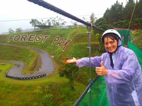 My wife, while I am taking the photo, at the hanging bridge to the go-cart ride. See the zigzag road, that is the track for our cart ride.