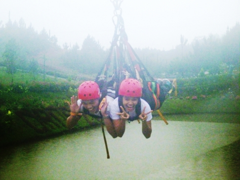 My children on the 850-meter long dual zip line. Note the hazy background due to intense rains.